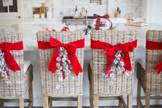 christmas-wreaths-on-the-back-of-chairs