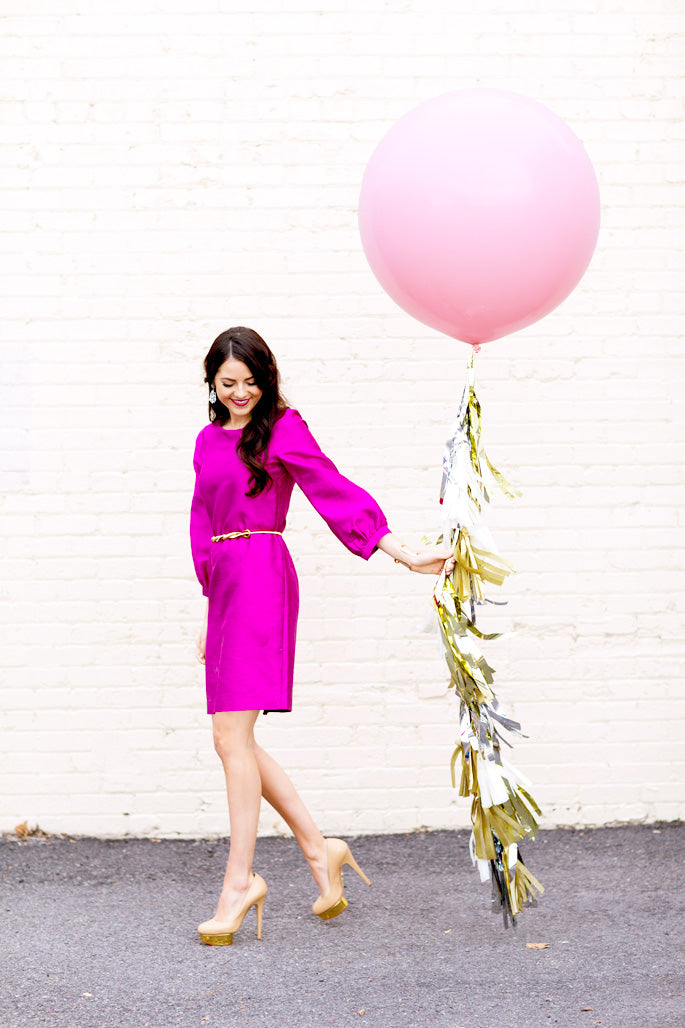 oversized-pink-balloon-with-tassels