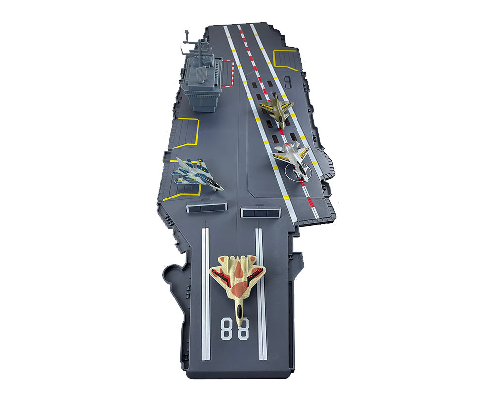 Detail of this durable plastic interactive extra large toy aircraft carrier playset includes 4 diecast metal jets, flashing runway lights, authentic sounds and a large storage compartment. Electronic Fleet Command Battle Zone brand playset. RedBox / Motormax