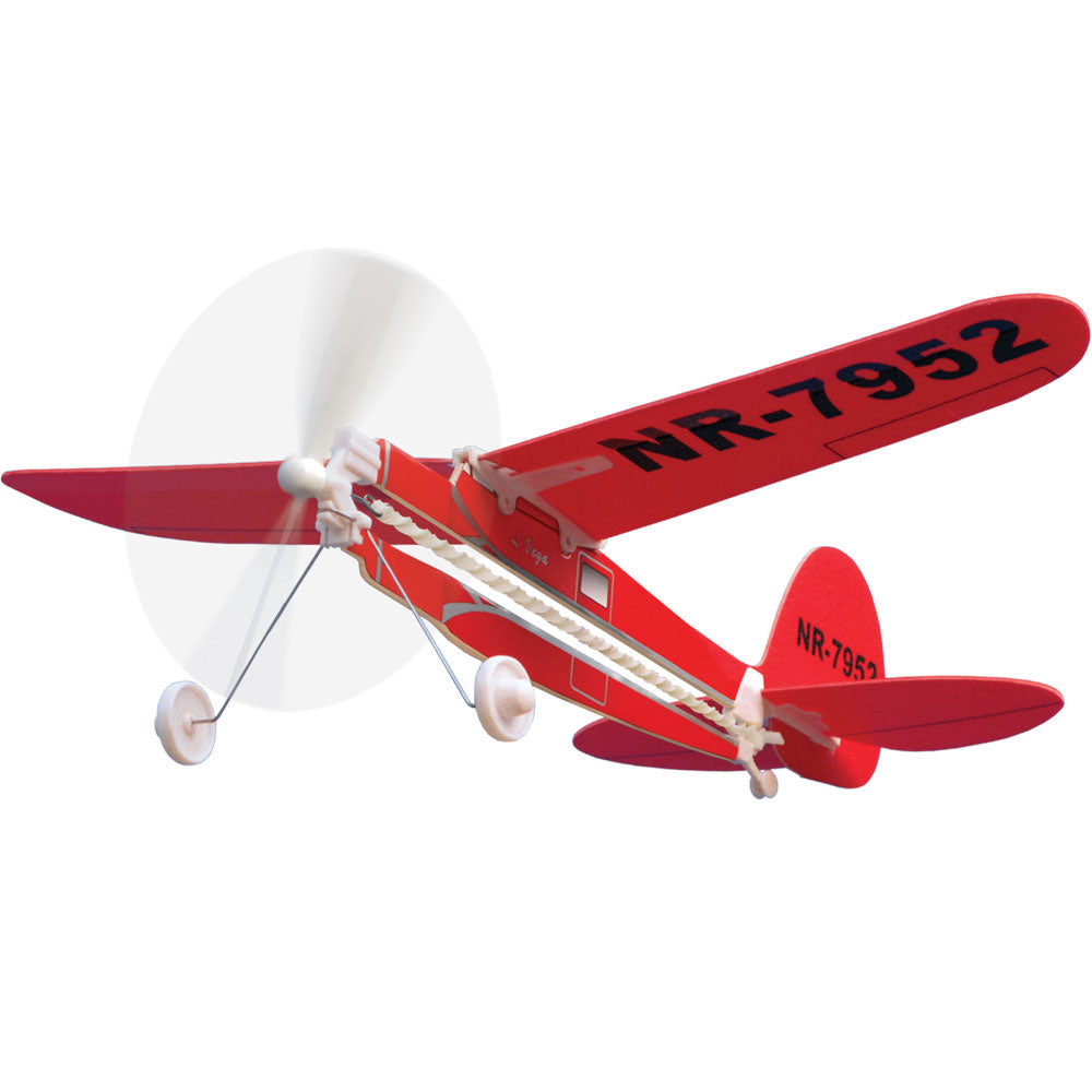 10 Inch Long Easy to Assemble Long Distance Red Lockheed Vega Flyer Aircraft as flown by Amelia Earhart with Rubber Band Powered Propeller and Realistic Details & Markings.