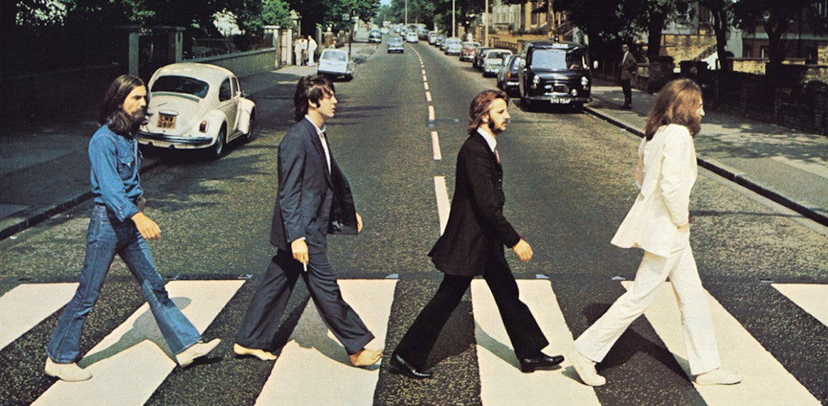 The Beatles cross Abbey Road