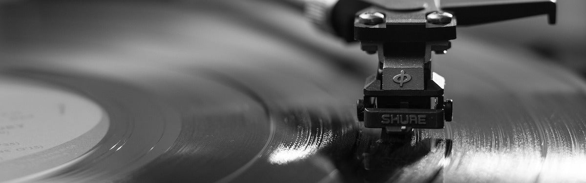 A turntable needle on a vinyl record