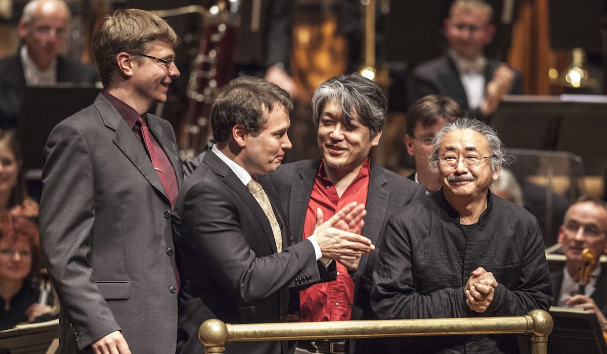Final Fantasy composers Masashi Hamauzu (second from right) and Nobuo Uematsu (far right) soak up applause at one of the many concerts showcasing their music.