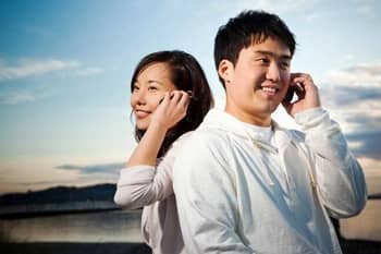 Chinese man and woman on the phone