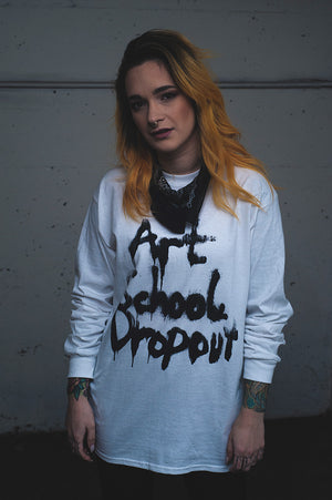 Open image in slideshow, Art School Dropout long sleeved tee worn by Elle Munster. Photo by Alex Pearson
