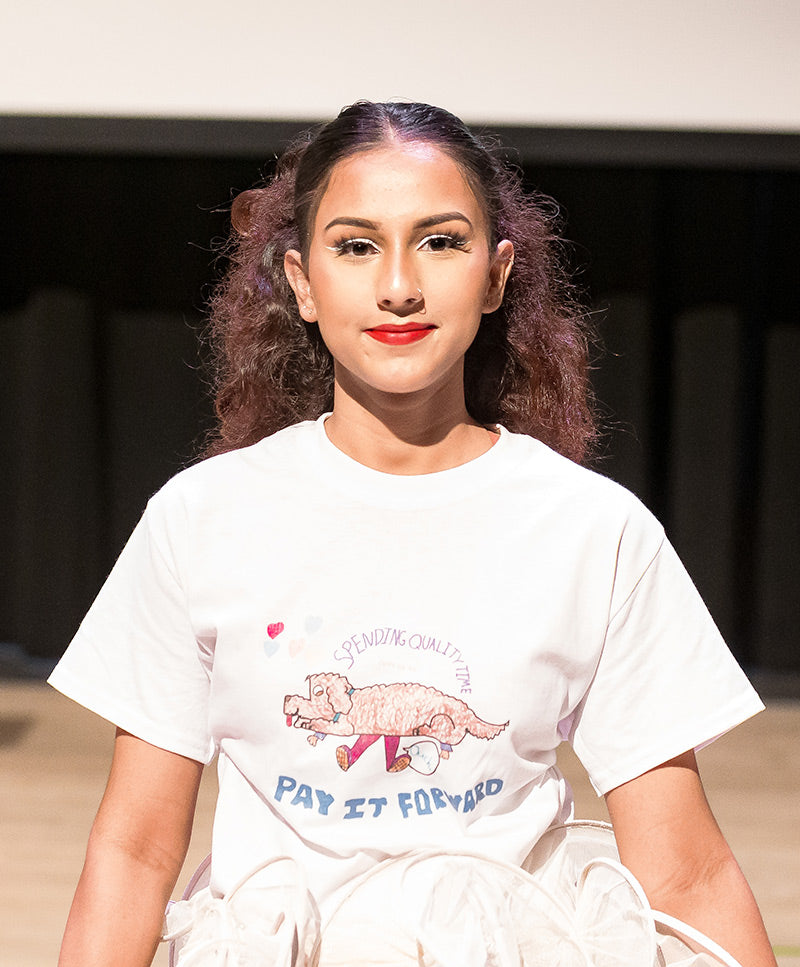 Pay It Forward Tee worn by Nisha during Moments In Culture