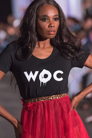 Open image in slideshow, Woman Of Colour Scoop Bottom Ladies Tee, Black worn by Solitha Shortte during Atlantic Fashion Week