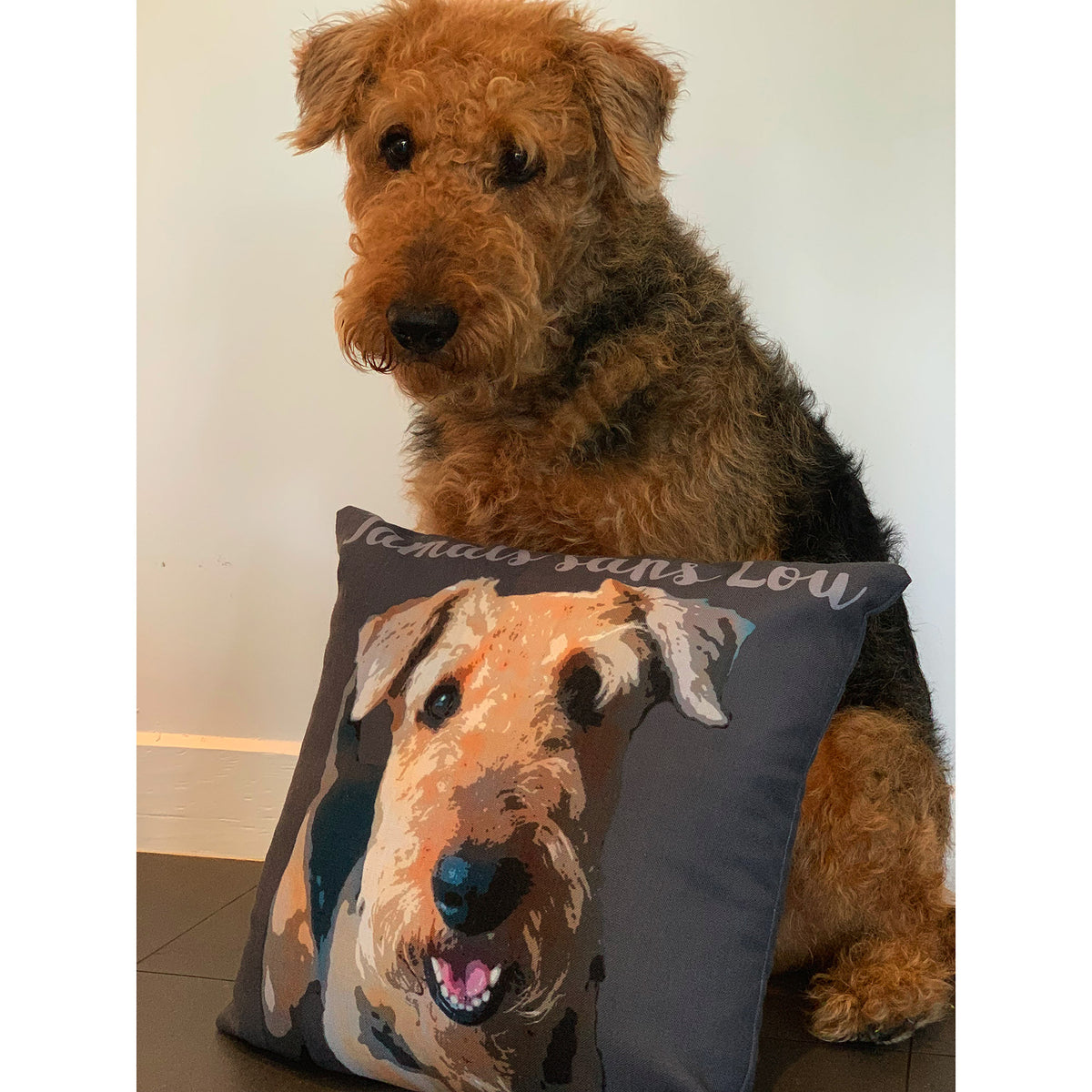 Airedale terrier with custom dog art on pillow