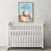 Pink Poster pop art of newborn baby boy displayed in a white nursery