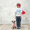 Boy wearing is personalized t-shirt pop art of his dog created from a photo
