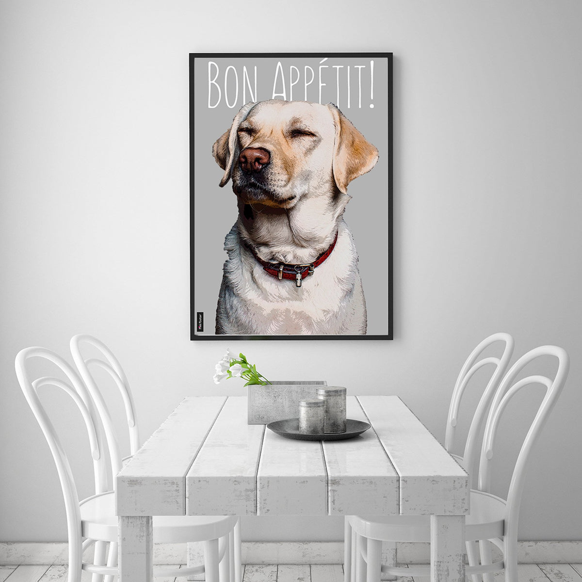 Custom pet portrait of Labrador retriever in a black frame displayed in a white dining room