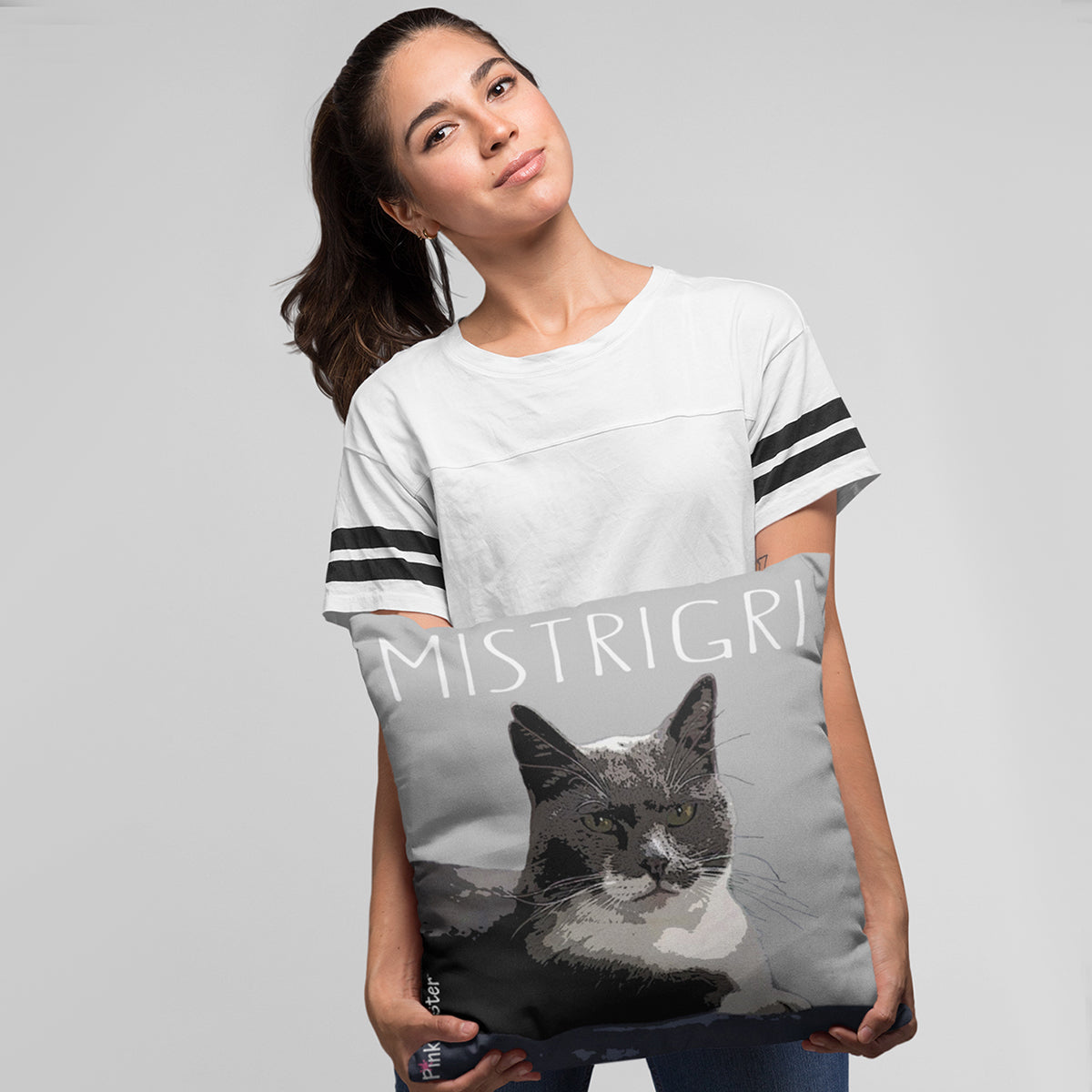 Young lady holding her PinkPoster pillow with her cat on it