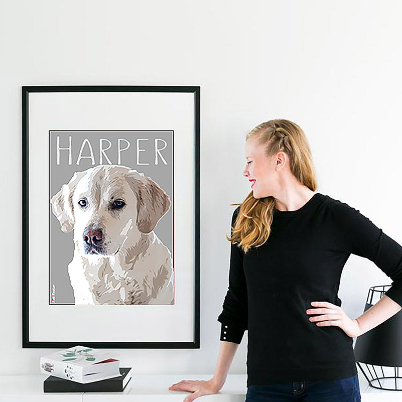 Lady looking at her custom pet art of her puppy