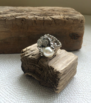 The Pearl and Flower Ring