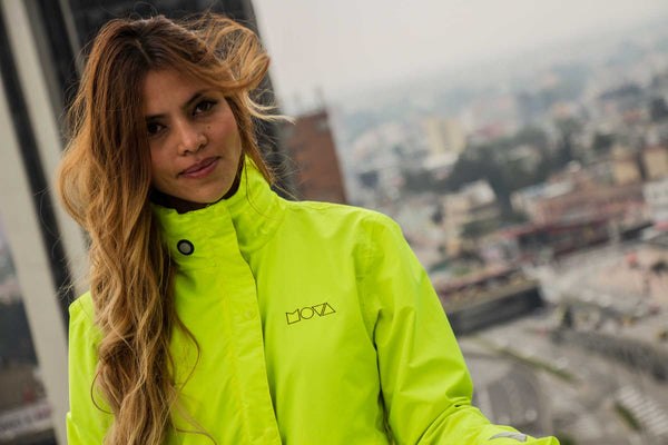 Lorena with a Yellow Reversible Light Waterproof Yellow Cycling jacket and jersey in a  Rooftop in Bogotá