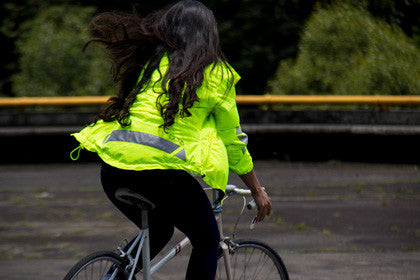 MOva Cycling jacket black and yellow his vis Laura riding her back