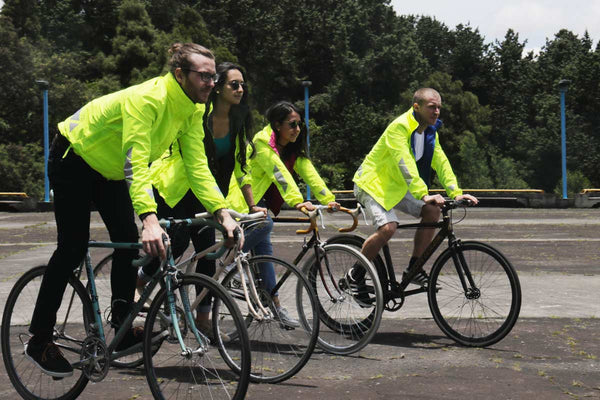 MOVA Team riding together with their MOVA reversible cycling jackets