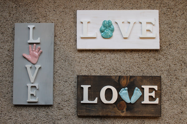 Love wooden sign with 3D ceramic handprint or footprints