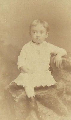 CDV PHOTO HANDSOME LITTLE VICTORIAN BOY IN NICE WHITE GOWN SEATED ON STUDIO ROCK - Back from the dead antiques