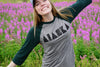 Alaska raglan t-shirt in a field of fireweed