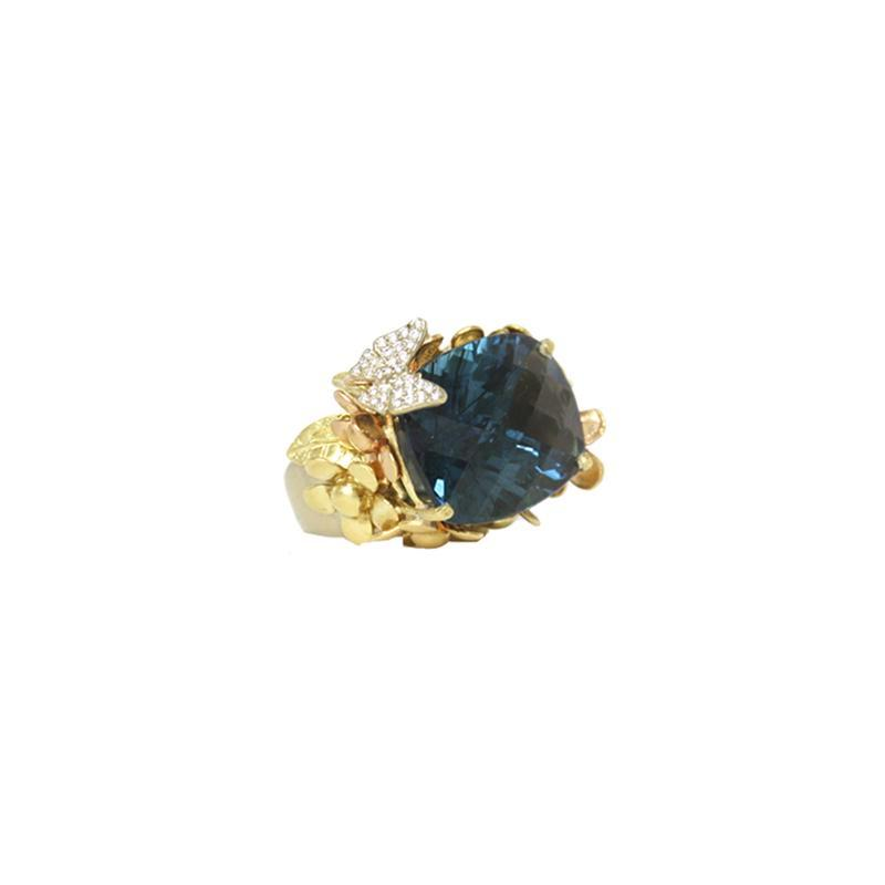 """A Fine Blue Topaz, Butterfly and Flower"" Ring"