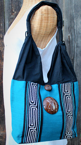 Handmade Cotton shoulder bag with hand embroidered design and hand-craved coconut shell accent