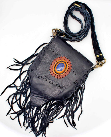 Handmade genuine leather bohemian saddle bag with fringe and premium stone accent