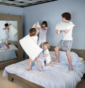 Kids playing on bed