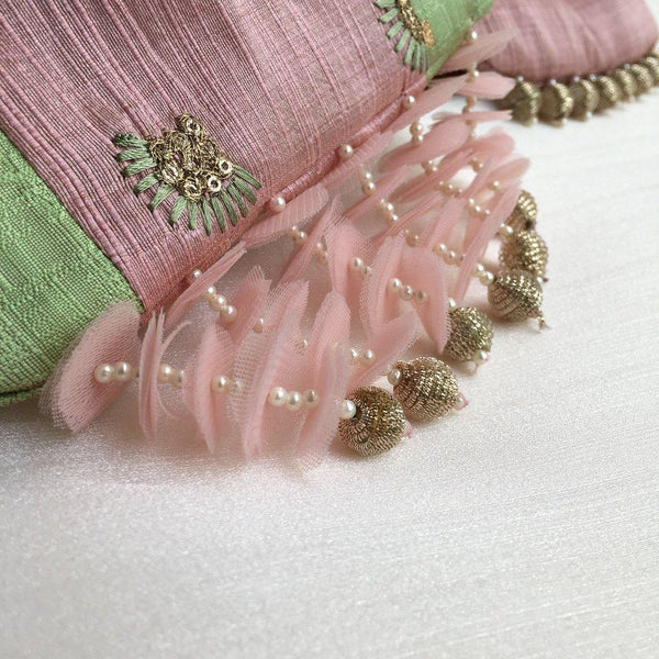 Pastel green and lilac potli with signature tassels and pearl handle