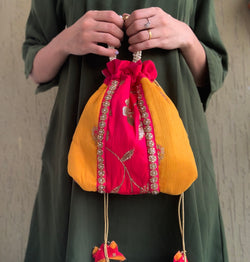 Yellow and pink bag with pearl handle and butterfly origami tassels