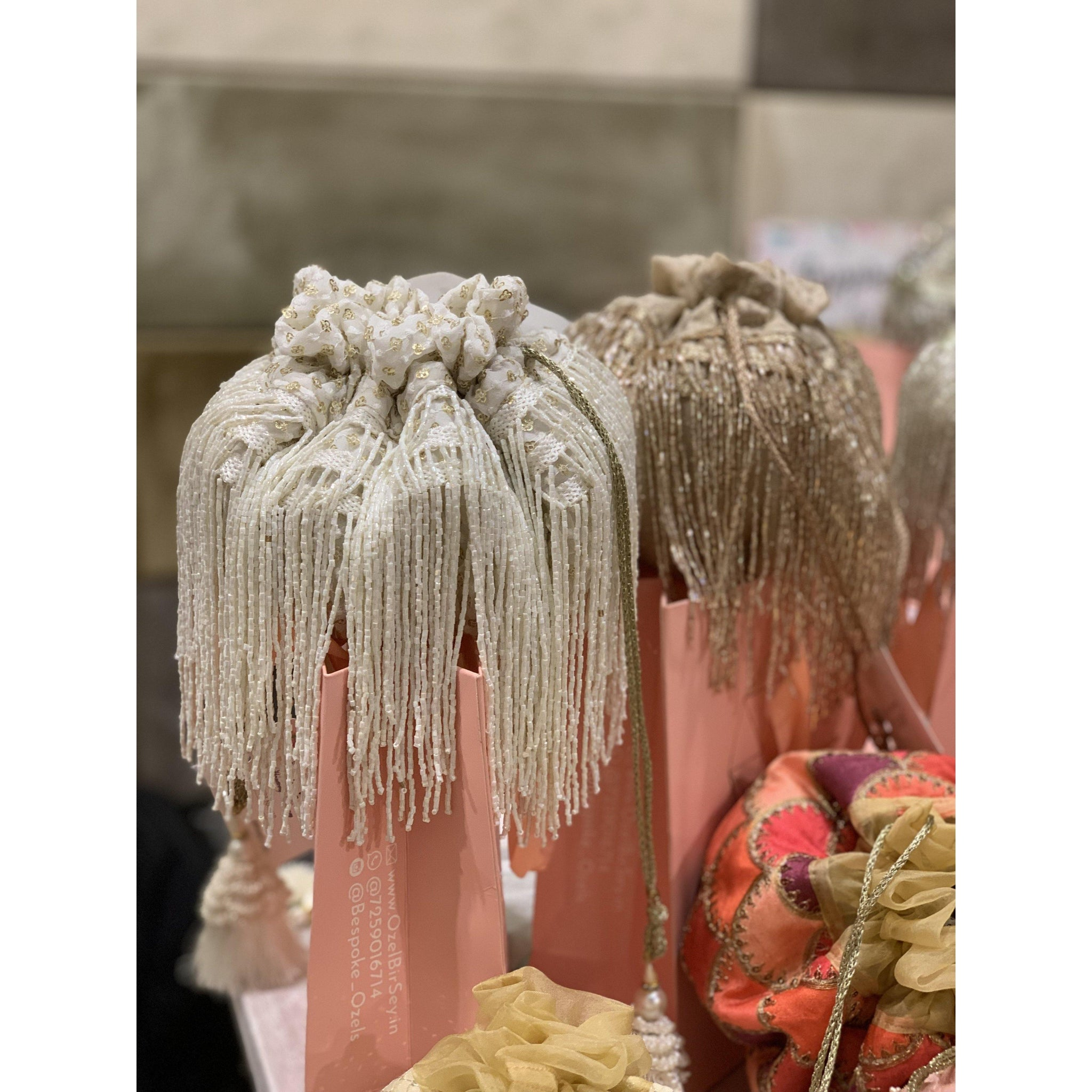 Cleopatra Collection: White Tassels Potli