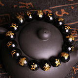 Black Obsidian Gold Carved Buddha Bracelet