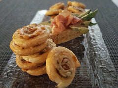 Gruyere & Prosciutto Pinwheels with Champagne