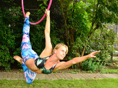 Warrior aerial hoop pose on the Netherlands's funniest event: Flexmonkey paaldans- acro yoga and aerial hoop event