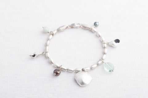 Shell bracelet with stones