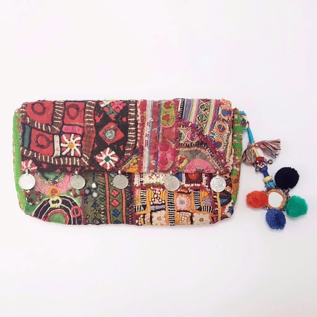 hot haveli llisa vintage tribal clutch bag with pompoms front