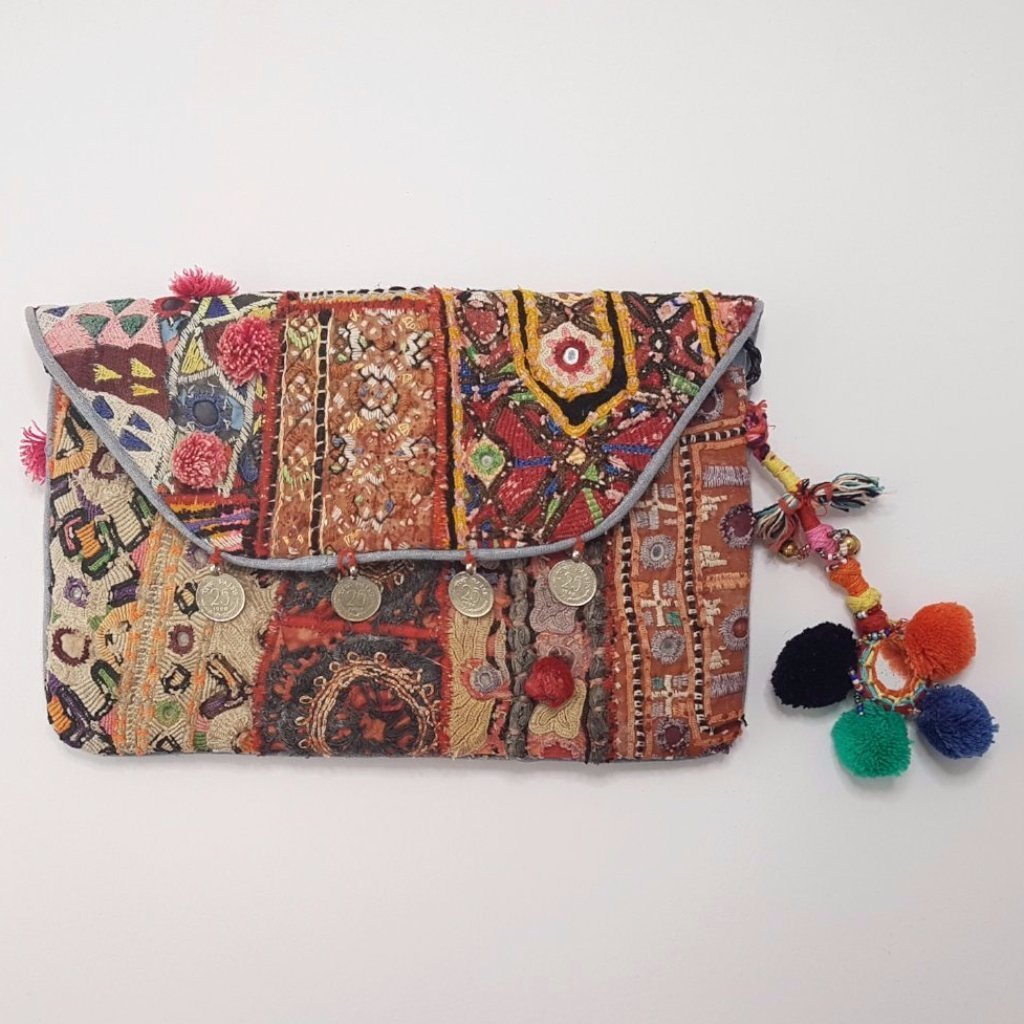 hot haveli vincenta vintage embroidered clutch with pompoms 2
