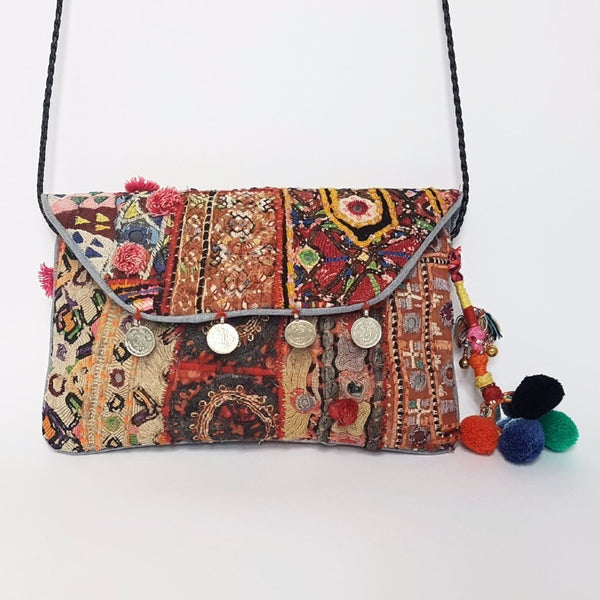 hot haveli vincenta vintage embroidered clutch with pompoms