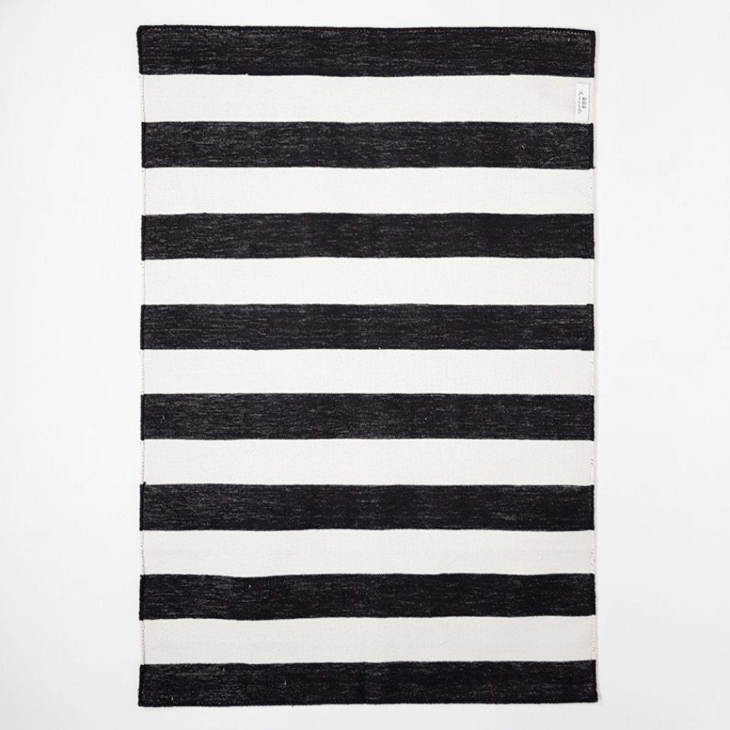 hot haveli caelan handwoven dhurrie rug mono black and ivory stripes 2