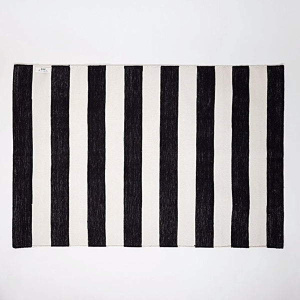 hot haveli caelan handwoven dhurrie rug mono black and ivory stripes