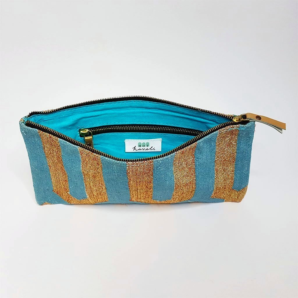 hot haveli eartha dhurrie clutch turquoise and gold inside