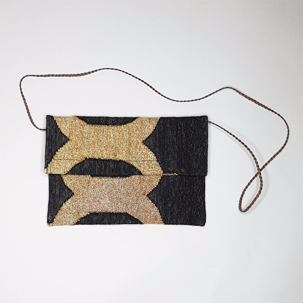 hot haveli eartha dhurrie shoulder clutch bag black and gold