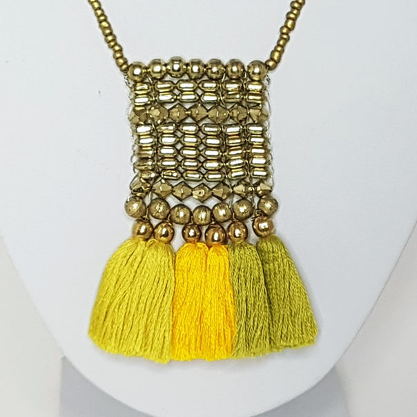 hot haveli kalena boho cotton tassel necklace mustard yellow close up