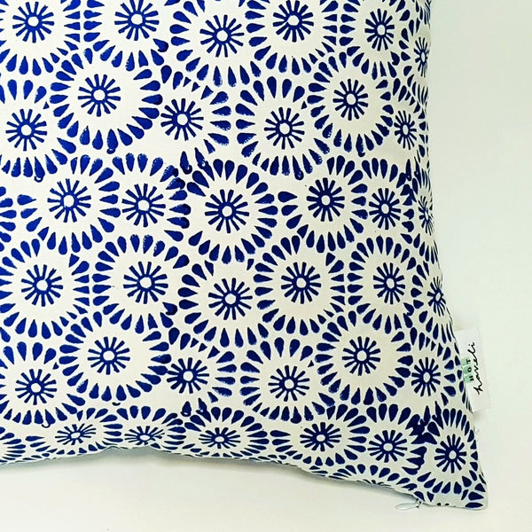 hot haveli petal hand block print blue cotton cushion close up