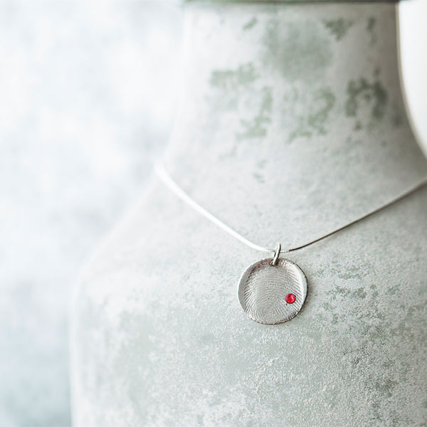 Priceless Prints Fine Silver Fingerprint Pendant with Swarovski Crystal Draped Over Vase