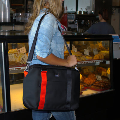 North Point Attaché ACME Made Blonde Girl Carrying Bag