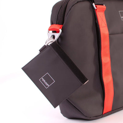 Mini Spring-top Pouch (Black) Attached to Backpack