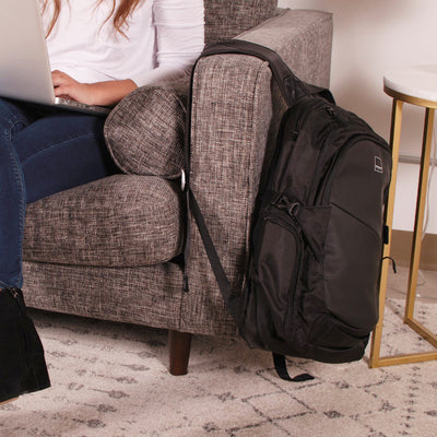 Union Street Traveler Backpack Girl on Couch