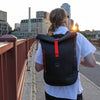 North Point Roll-Top Backpack ACME Made Guy Holding Bag Minneapolis