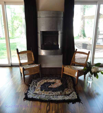 Brown and gray square spiral in front of the fireplace.